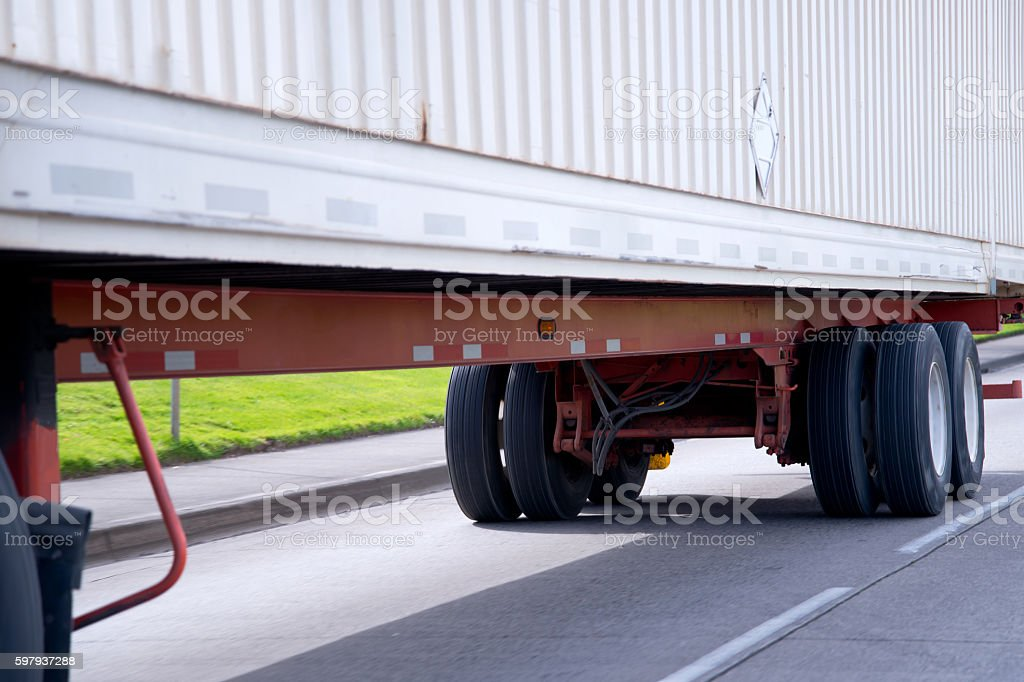 Semi trailer wheelbase chassis frame with trailer axles stock photo