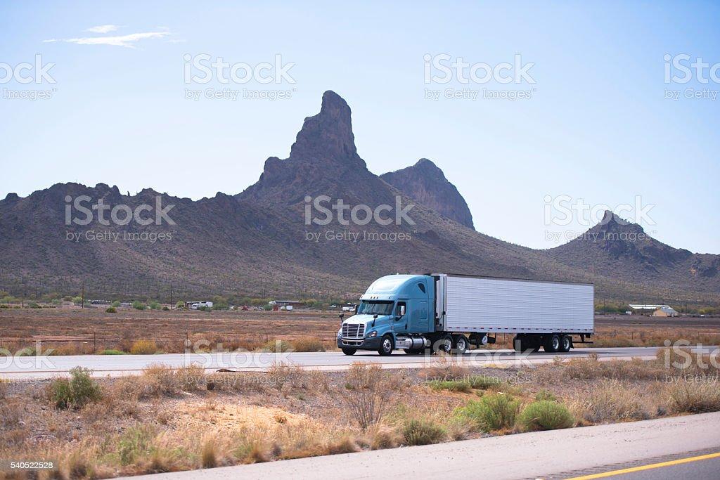 Semi truck and trailer on road with Arizona mountain stock photo