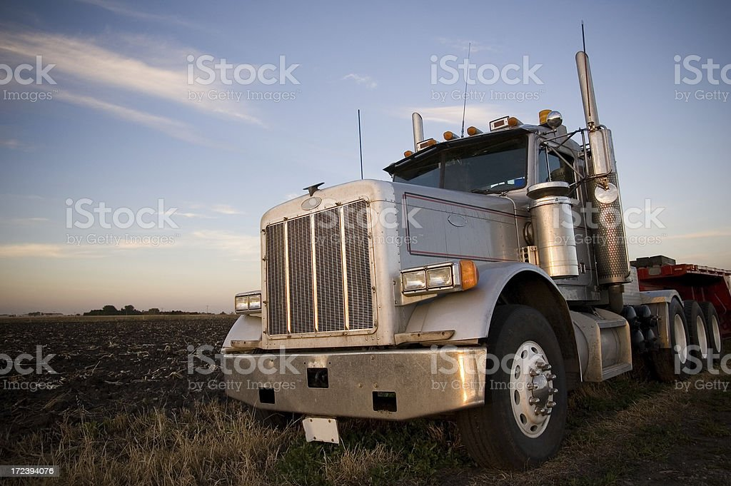 Semi truck at dusk stock photo