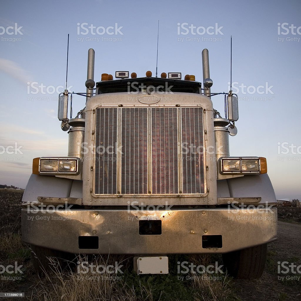 Semi truck at dusk stock photo
