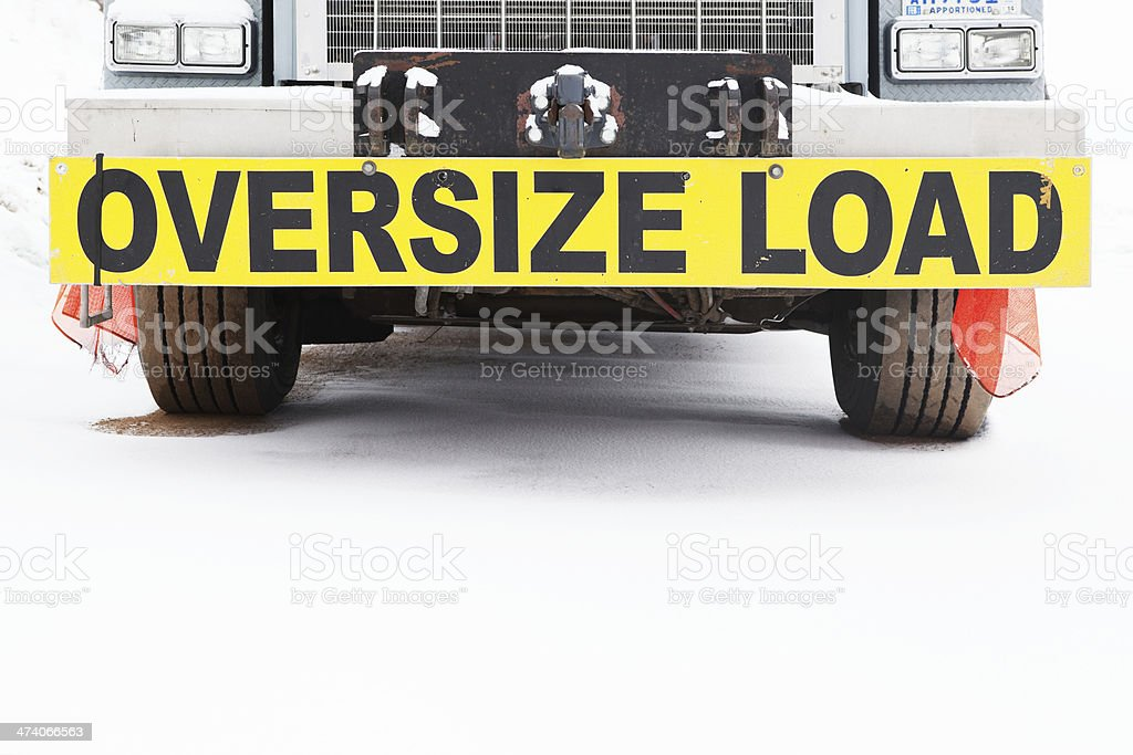 Semi Truck Bumper with Oversize Load Sign on Snow stock photo