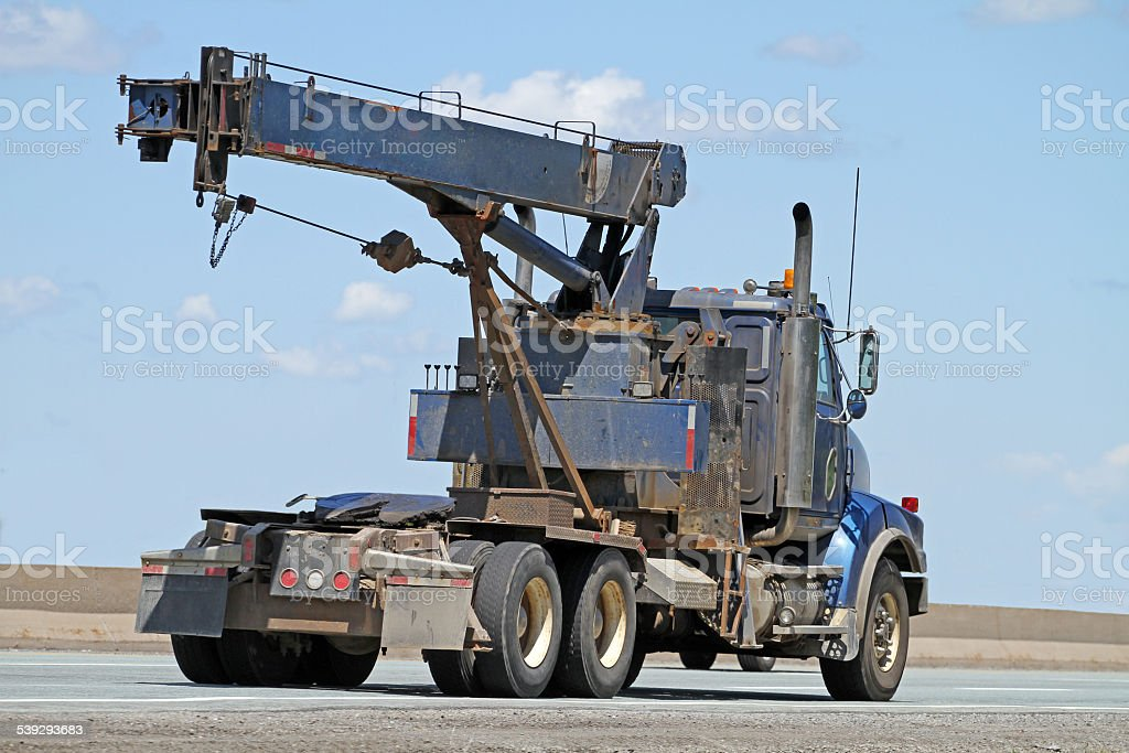 Semi Truck Cab Equipped With Boom Lift Travelling On Highway stock photo