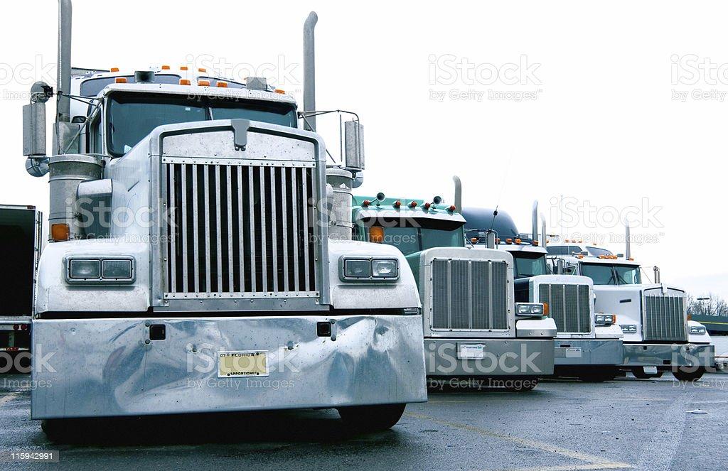 Semi Truck Convoy at a Truckstop stock photo