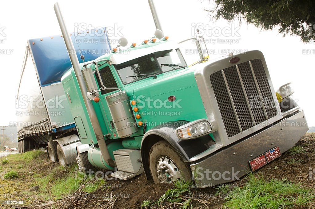 semi truck drives off the road stock photo