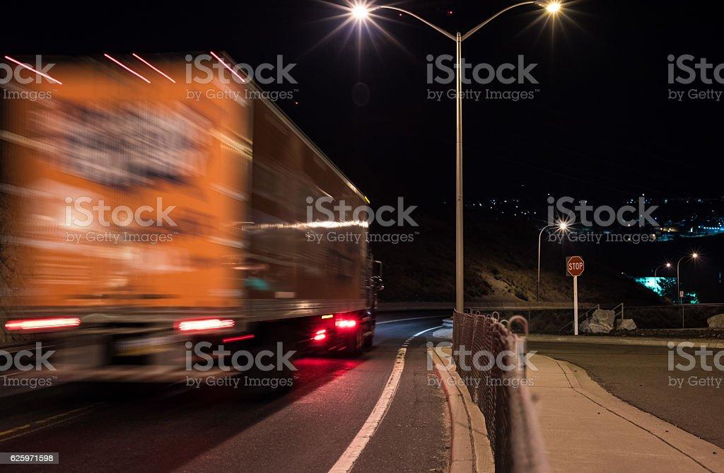 Semi Truck driving at Night stock photo
