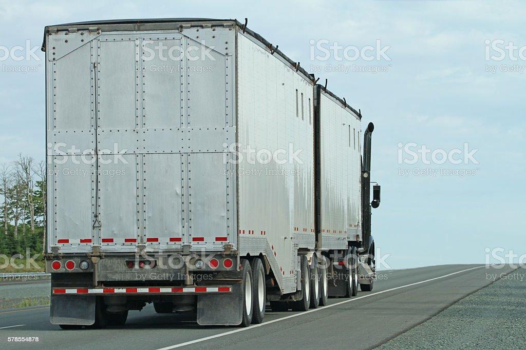 Semi Truck Hauling  Double Trailer, Often Called  B-Train stock photo