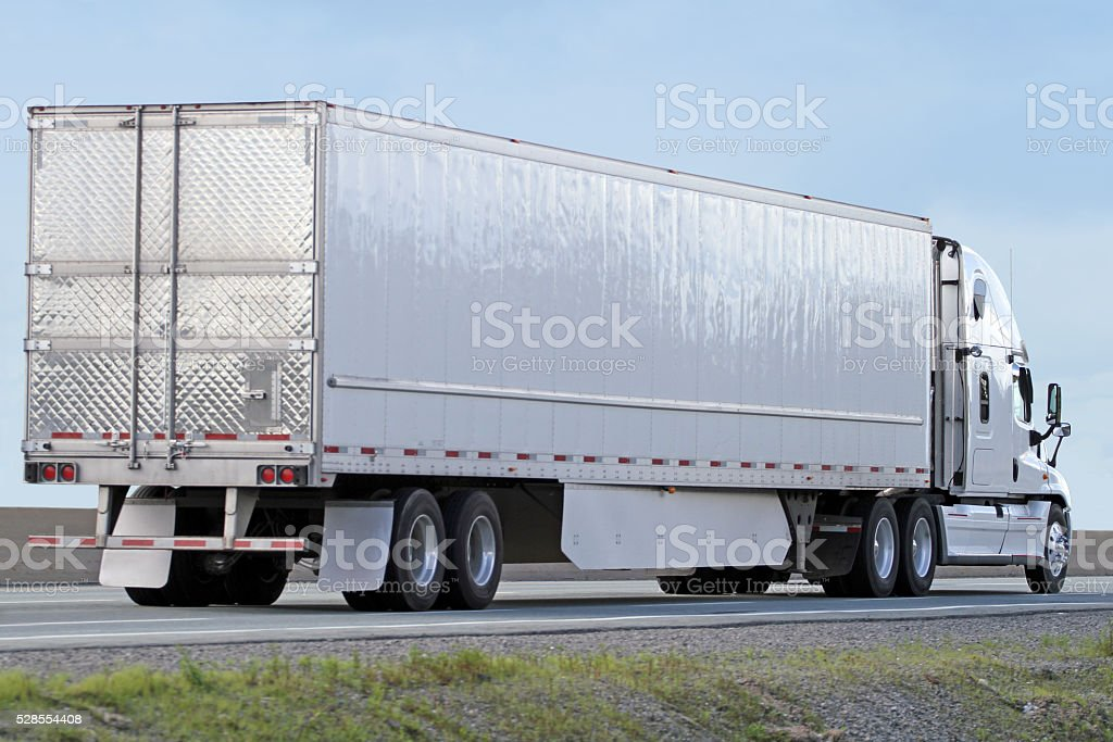 Semi Truck Hauling Freight On An Interstate Highway stock photo