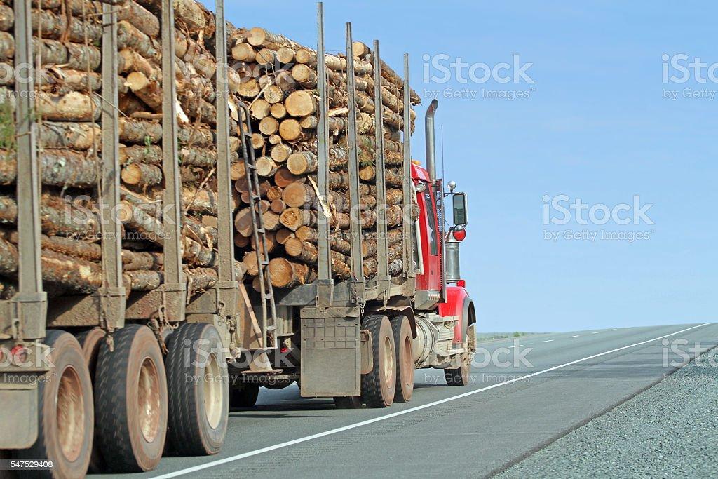 Semi Truck Hauling Logs On An Interstate Highway, Closeup View stock photo