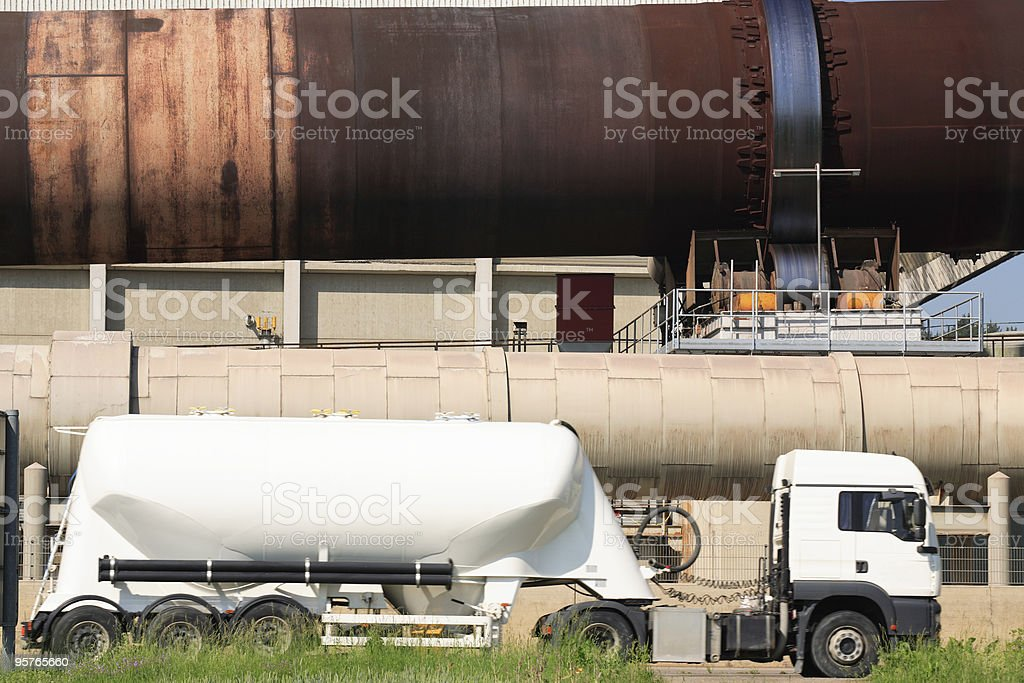 Semi Truck in Front of Cement Factory royalty-free stock photo