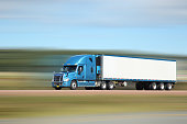 Semi truck on interstate, lots of motion blur