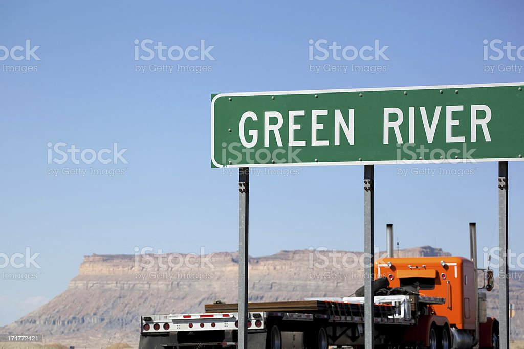 semi truck road sign desert landscape royalty-free stock photo
