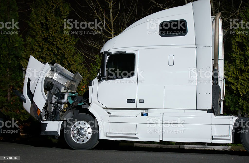 Semi truck with open hood and engine repairs stock photo