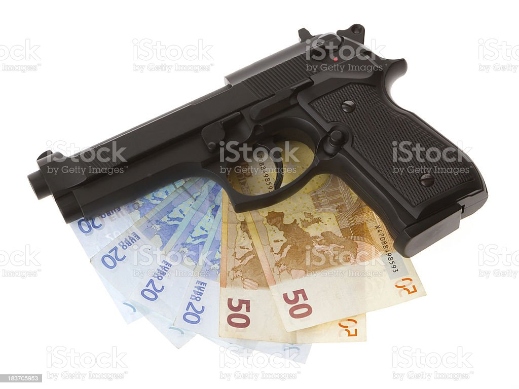 Semi-automatic gun and money isolated royalty-free stock photo