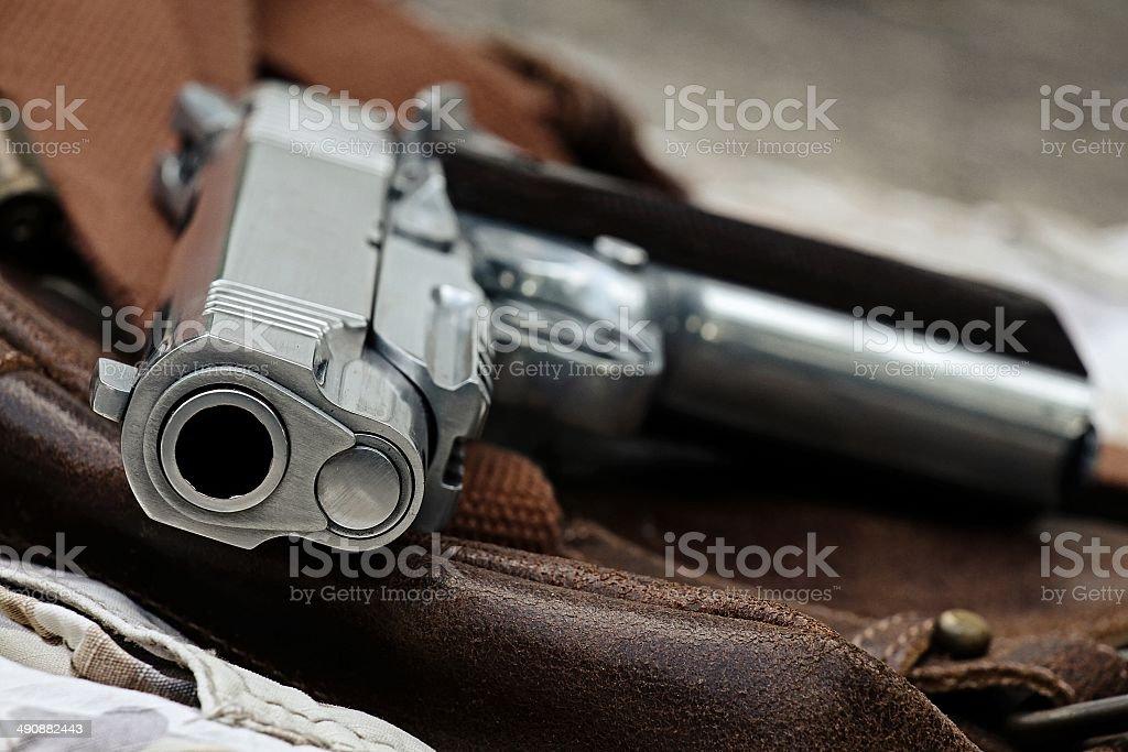 Semi-automatic handgun lying over a Leather handbag, .45 pistol stock photo