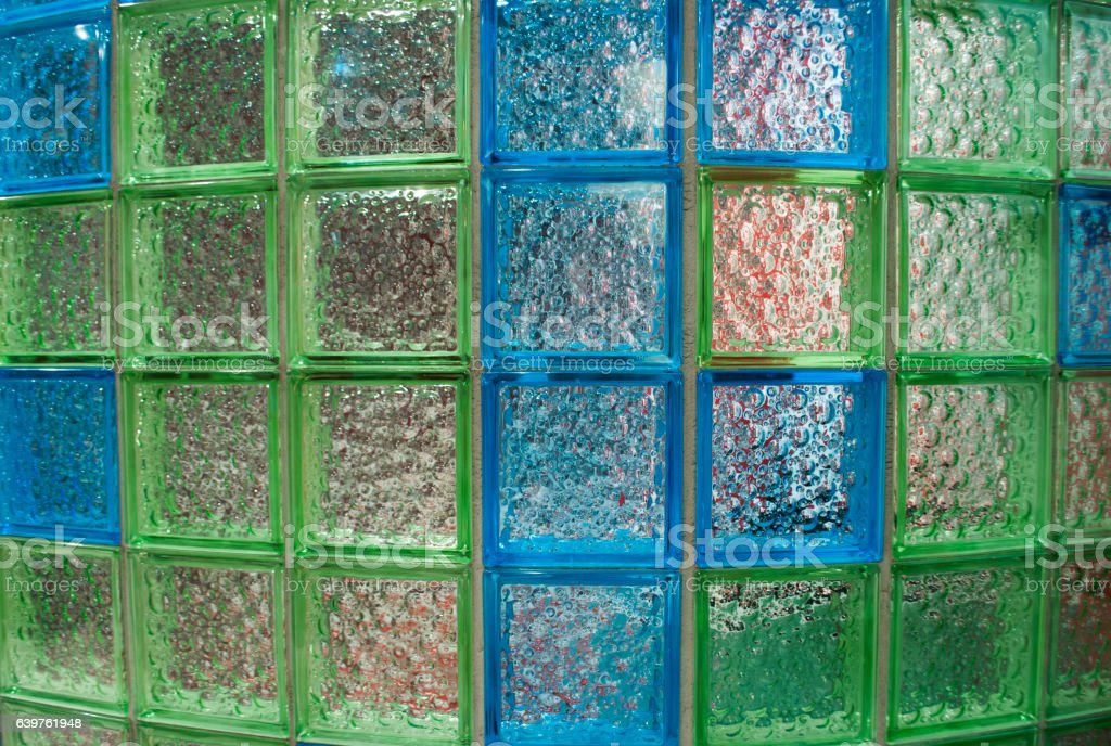 Semicircular wall made of glass tiles in the bathroom stock photo