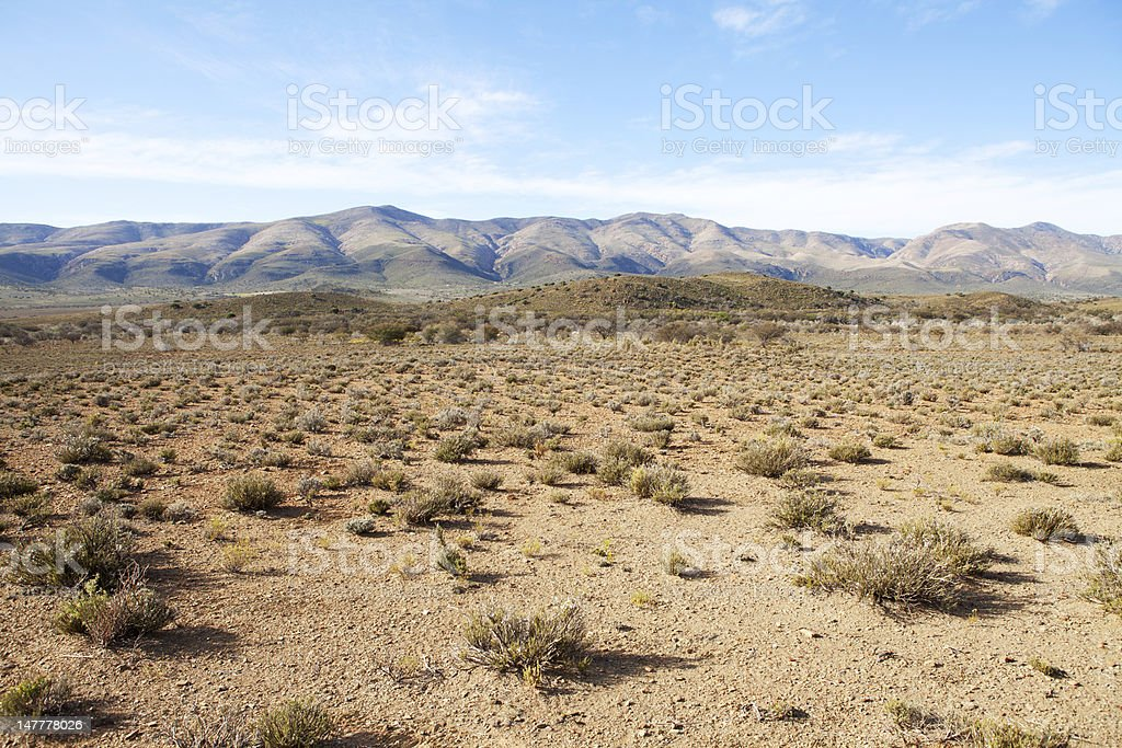 Semi-desert region with mountains and blue sky stock photo