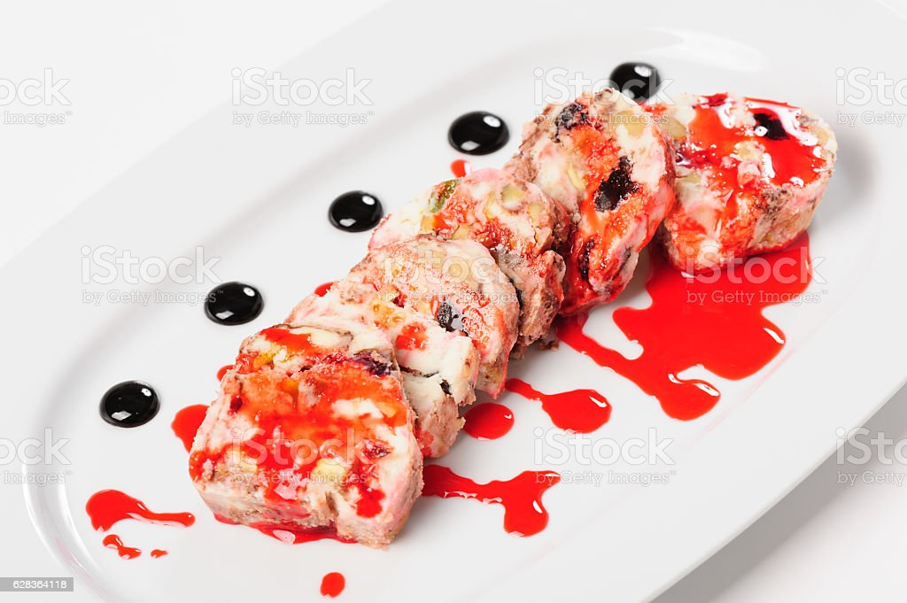 Semifreddo dessert with forest fruits and pistachio nuts stock photo