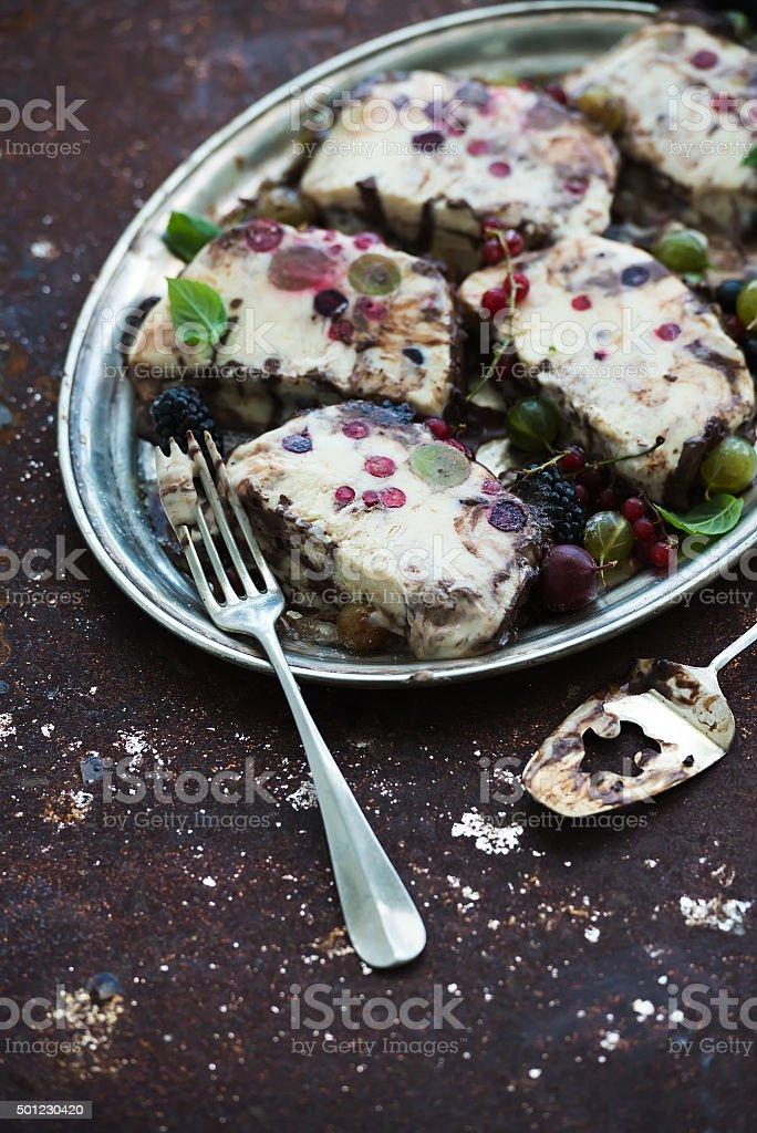 Semifreddo or italian cheese ice-cream dessert with garden berries stock photo