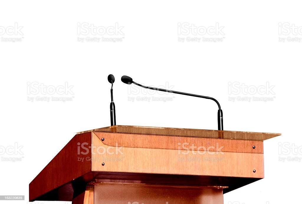 Seminar podium and microphones over white royalty-free stock photo