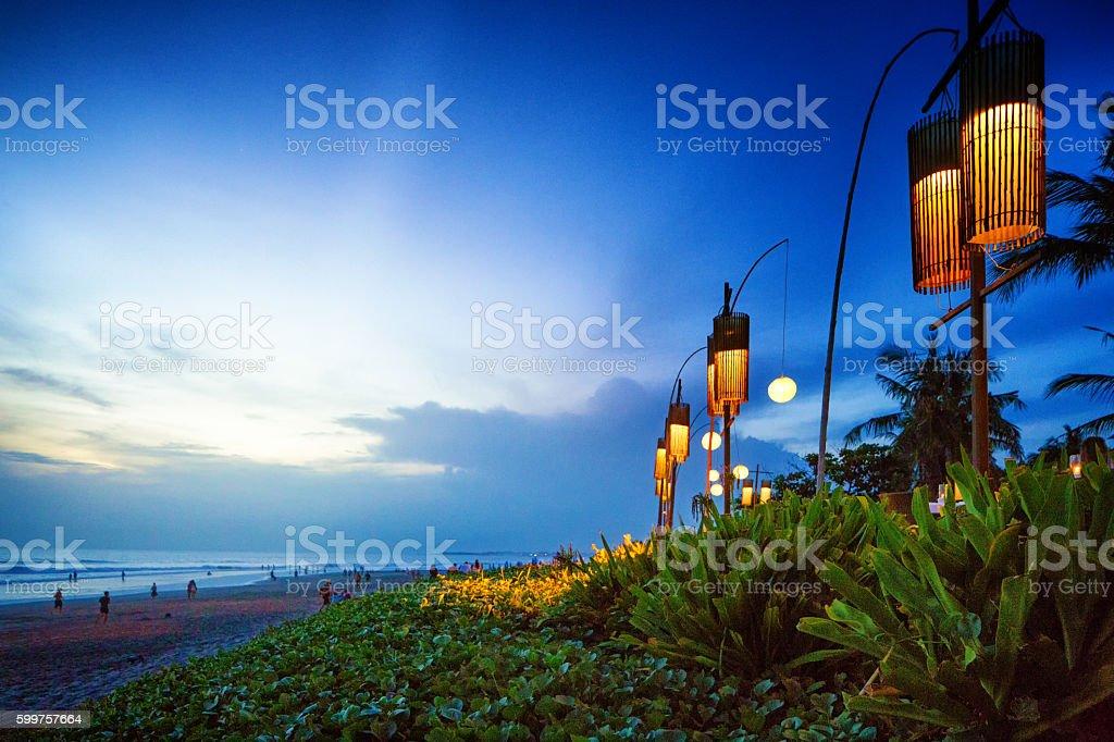 Seminyak Denpasar Bali Indonesia beach at sunset with lanterns stock photo