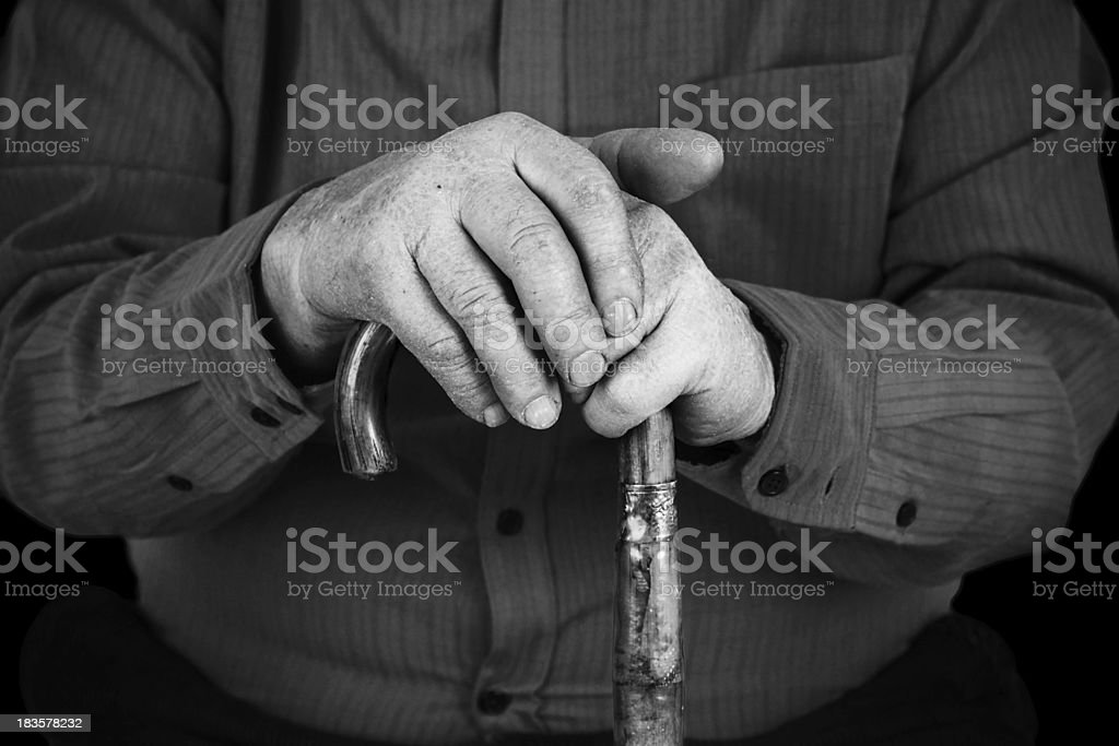 Semior's hands on cane royalty-free stock photo