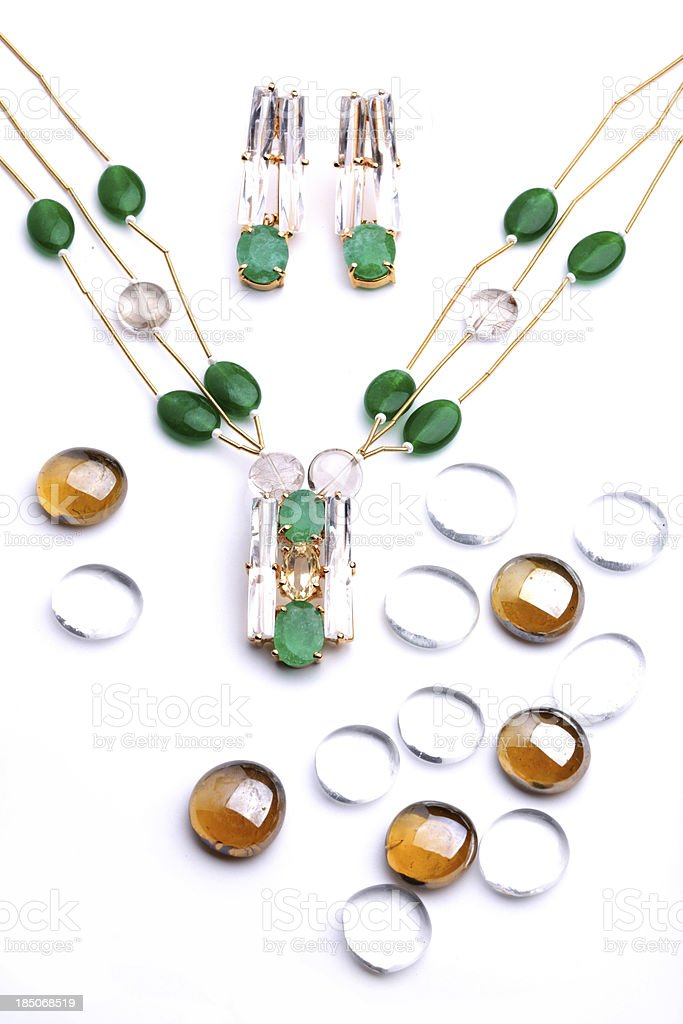Semi-Precious Green Gemstone and Quartz Pendants on Gold String royalty-free stock photo