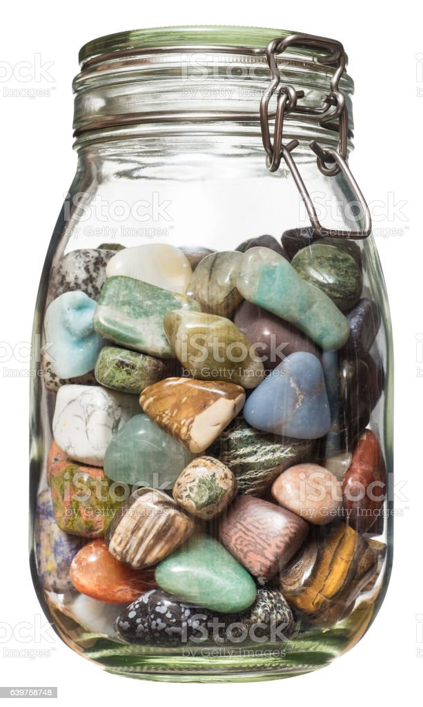 Semiprecious stones canned in glass jar. stock photo