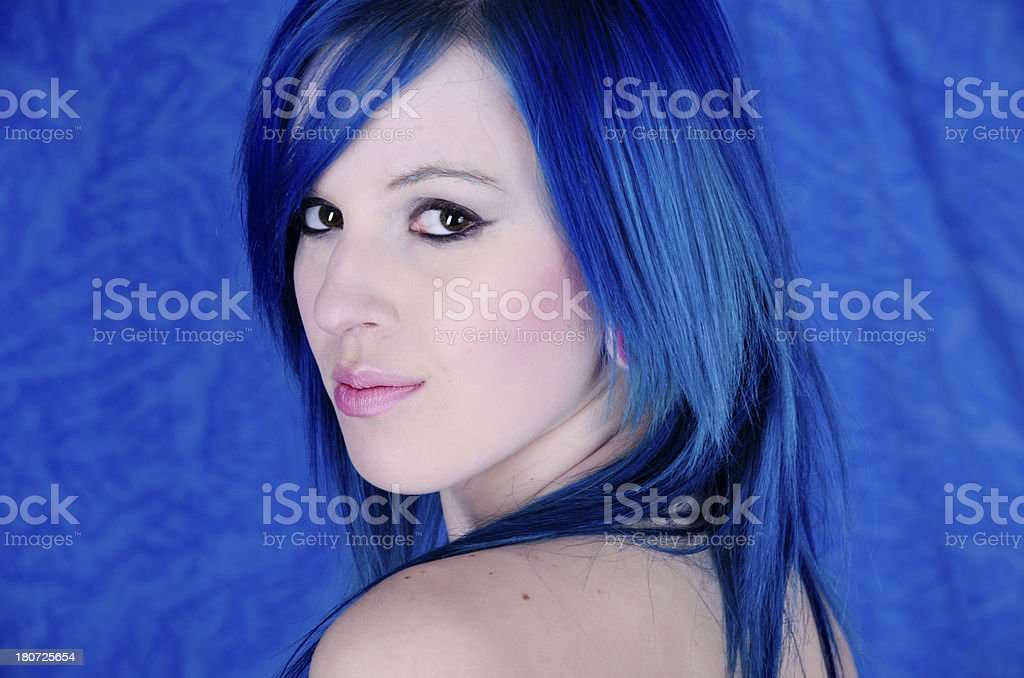 Semi-profile of young woman with knowing smile. royalty-free stock photo