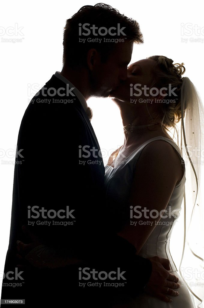 semi-silhouette of bride and groom, kissing royalty-free stock photo