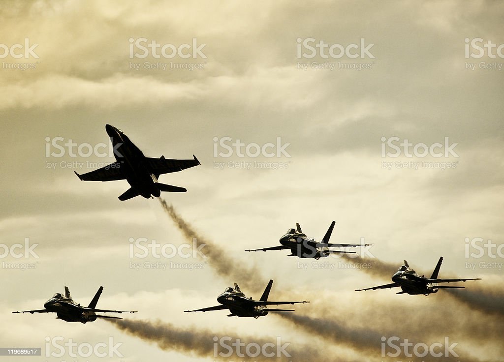 Semi-Silhouetted Jets on Dramatic Sky stock photo