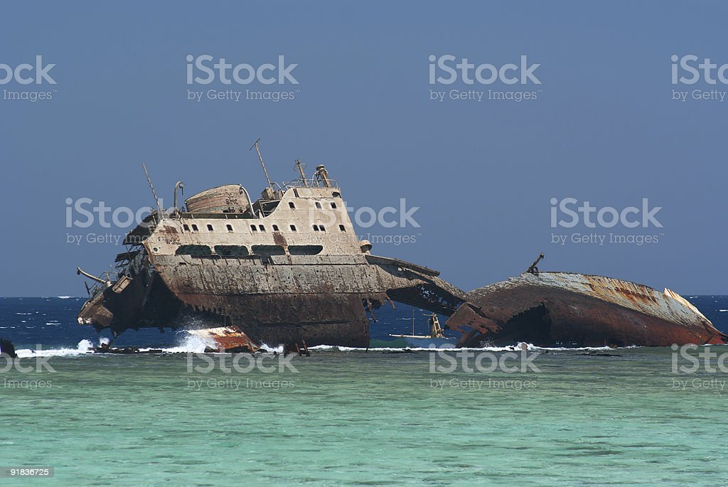 Semi-submerged, rusted, shipwreck. royalty-free stock photo