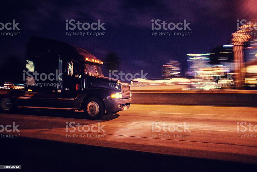 semi-truck at night stock photo