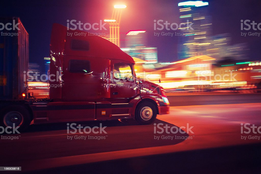 semi-truck at night stock photo