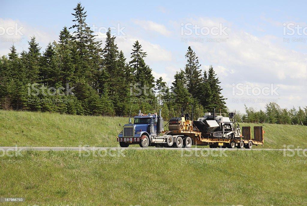 Semi-truck hauling paving equipment royalty-free stock photo