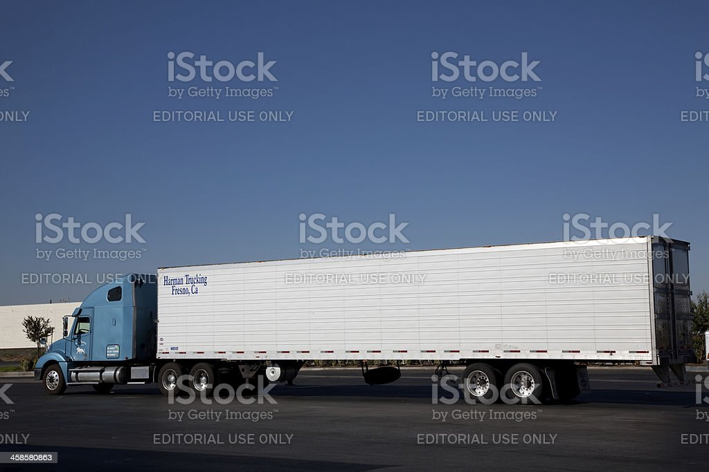 Semi-truck parked on truck stop stock photo