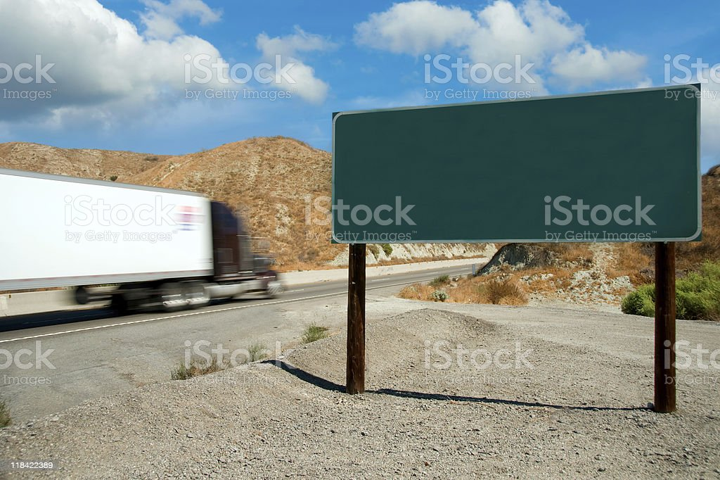 Semi-Truck Traveling on a Highway royalty-free stock photo