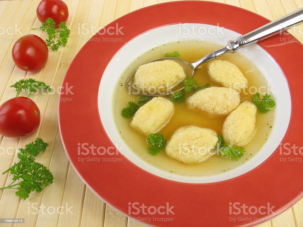 Semolina dumplings soup stock photo