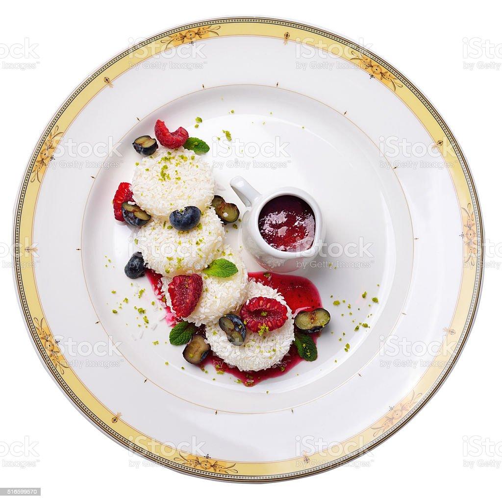 semolina gnocchi with raspberries, blueberries and berry jam stock photo