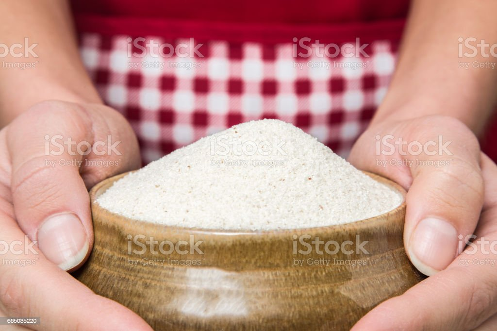 Semolina in the bowl in the kitchen. Children's favorite porridge. Healthy eating and lifestyle. stock photo