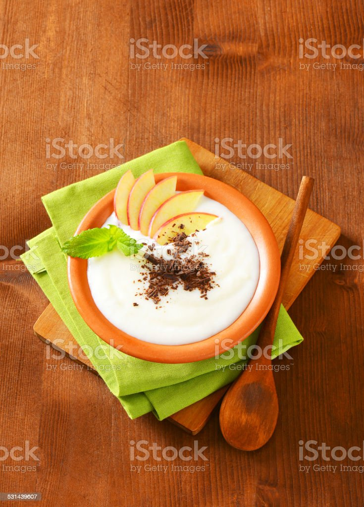 Semolina or rice pudding with apple and chocolate stock photo