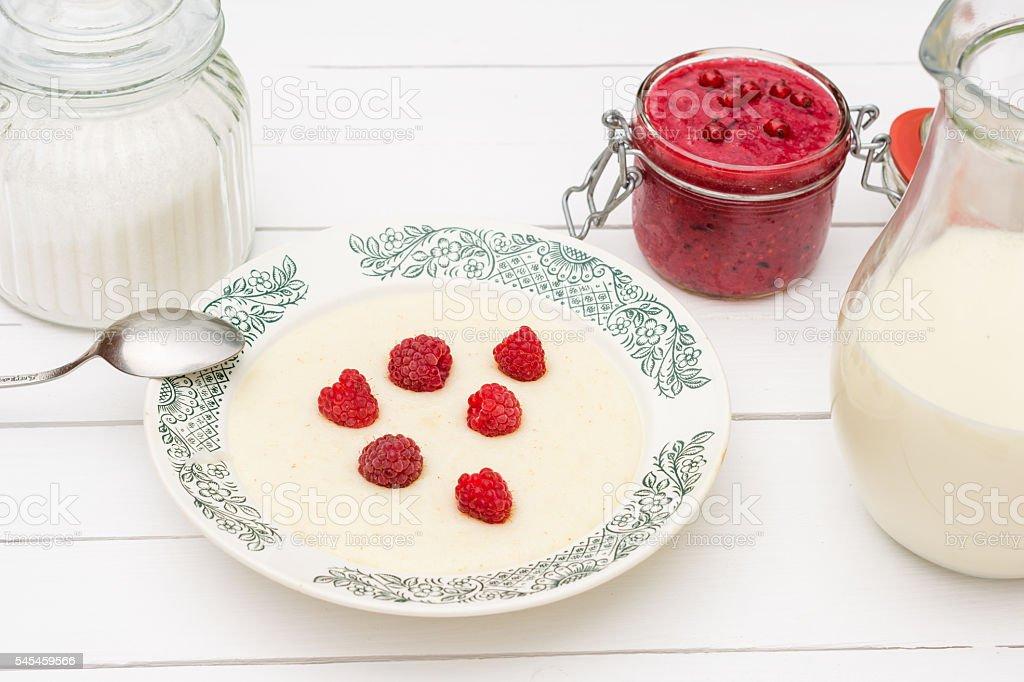 Semolina porridge with raspberries stock photo