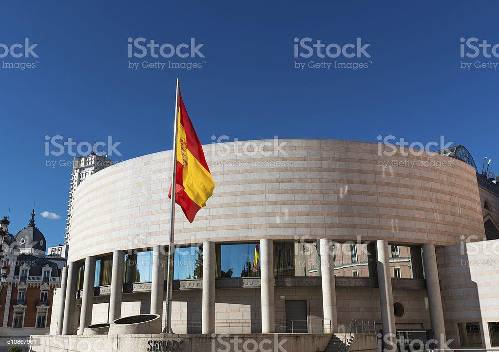 Senate building and Spanish flag in Madrid stock photo