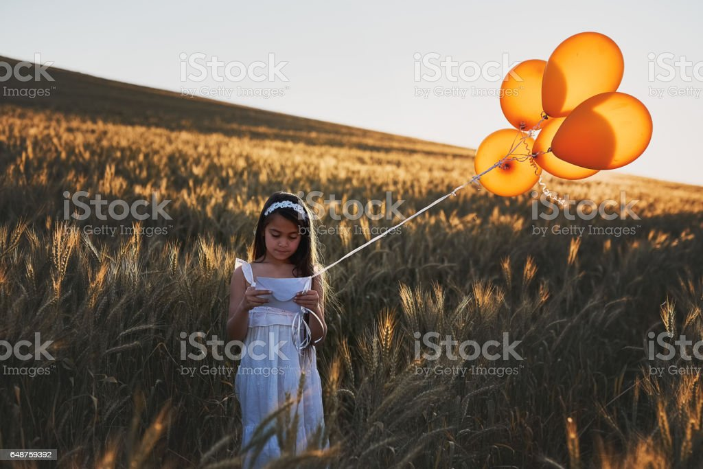 Sending a letter on the wind stock photo