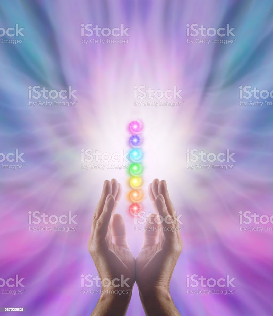 Sending Chakra Healing Energy stock photo