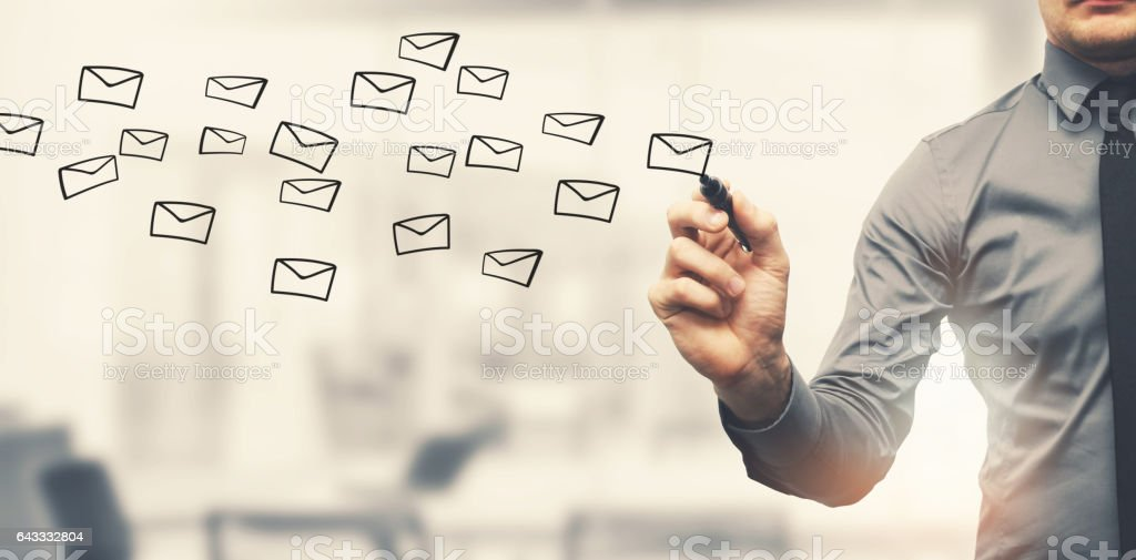 sending email concept - businessman drawing envelopes in offiice stock photo
