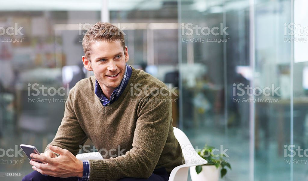 Sending his client a project update stock photo
