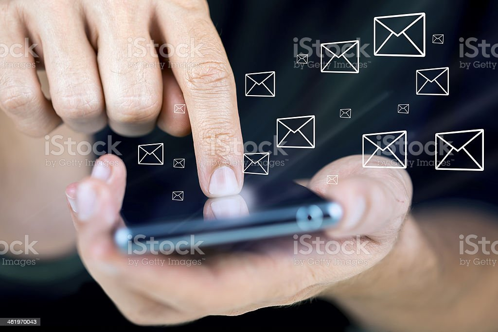 Sending messages on a smartphone concept stock photo