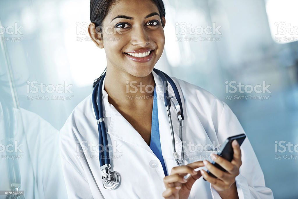 Sending off a quick text before my next procedure stock photo