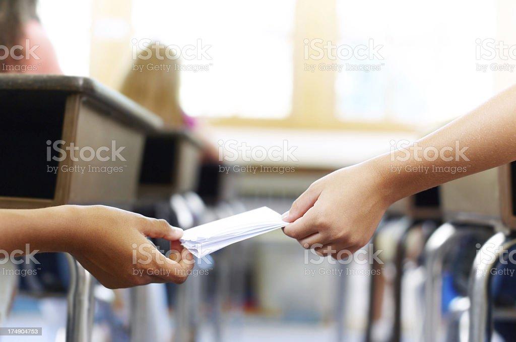 Sending secrets during class stock photo