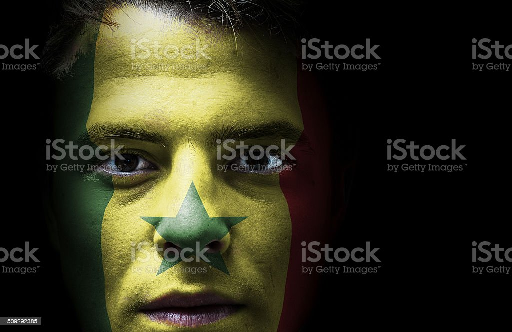 Senegal flag on face stock photo